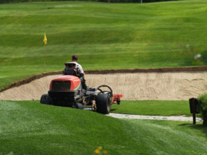 image of a greenkeeper maintaining a golf course